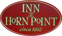 "oval sign reading ""INN AT HORN POINT circa 1902"" with gold lettering and red setting with transparent background"